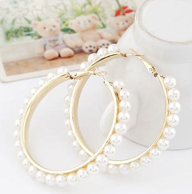 Бижута-обеци от стомана и естествени перли